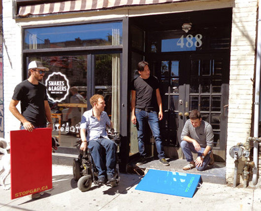 Luke out front of snakes and lagers cafe with 3 men and 2 new ramps
